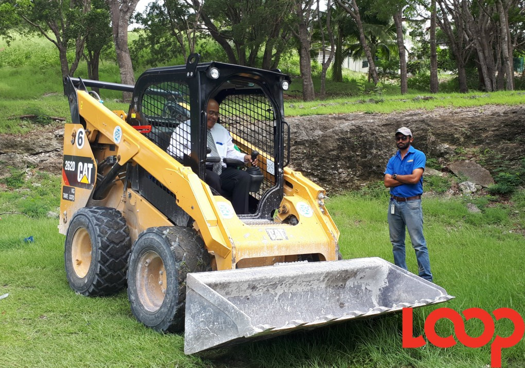 In October last year, Transport, Works and Maintenance MInister William Duguid (pictured in the skid loader), 'cleared ground' to mark the start of a $50-million Road Rehabilitation and Improving Connectivity of Road Infrastructure Project sponsored by Inter-American Development Bank (IDB).