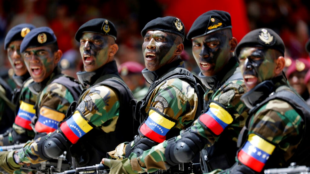 Soldiers march during a military parade marking Independence Day in Caracas, Venezuela, Friday July 5, 2019. Venezuela is marking 208 years of their declaration of independence from Spain. (AP Photos/Ariana Cubillos)