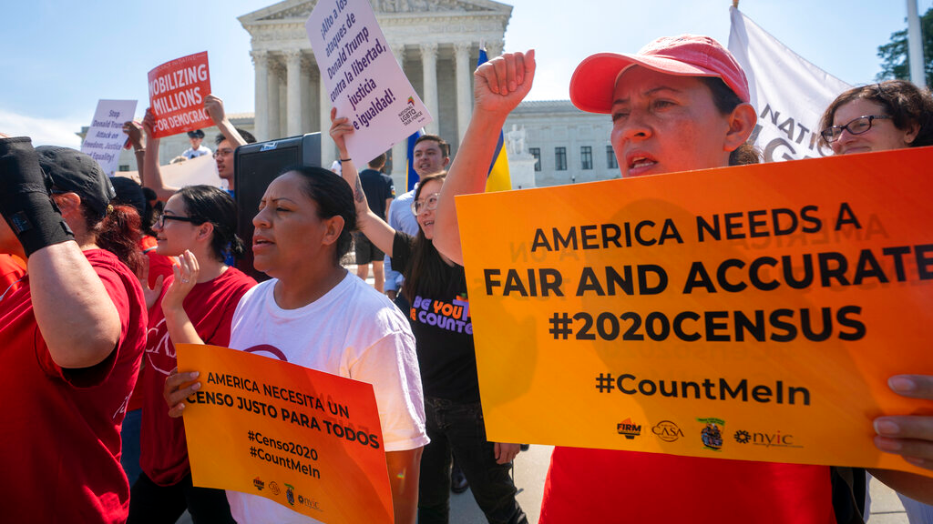 Photo dated June 27, 2019: Demonstrators gathered at the Supreme Court as the justices finish the term with key decisions on gerrymandering and a census case involving an attempt by the Trump administration to ask everyone about their citizenship status in the 2020 census, on Capitol Hill in Washington. (AP Photo/J. Scott Applewhite, File)