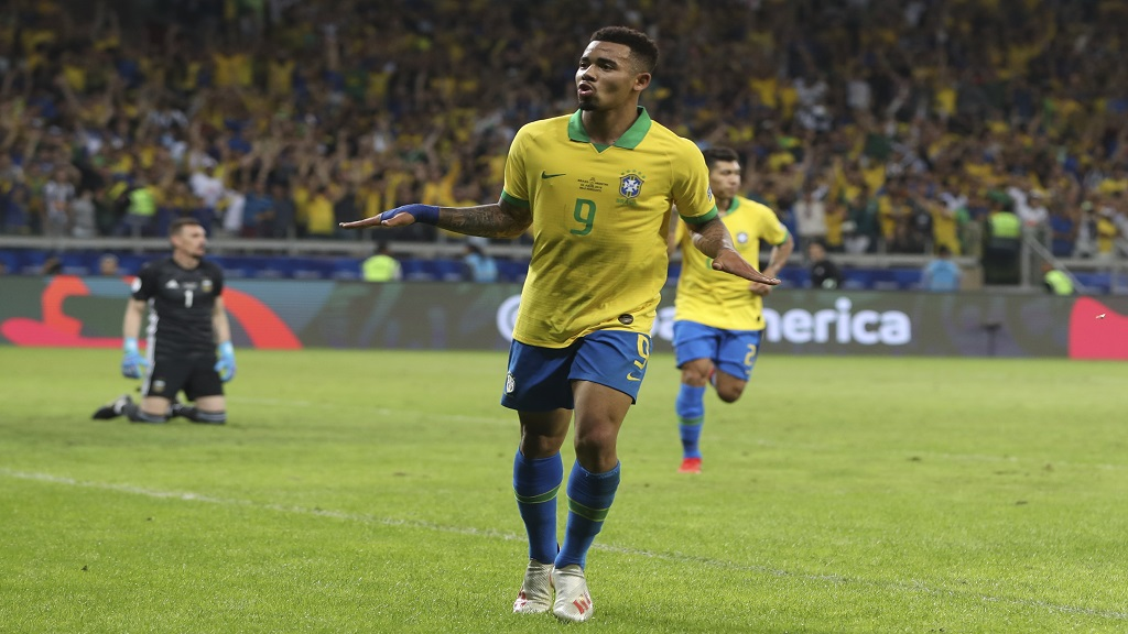 Brazil's Gabriel Jesus celebrates his side's second goal scored by teammate Roberto Firmino, back, during the Copa America semifinal football match against Argentina at the Mineirao stadium in Belo Horizonte, Brazil, Tuesday, July 2, 2019. (AP Photo/Ricardo Mazalan)