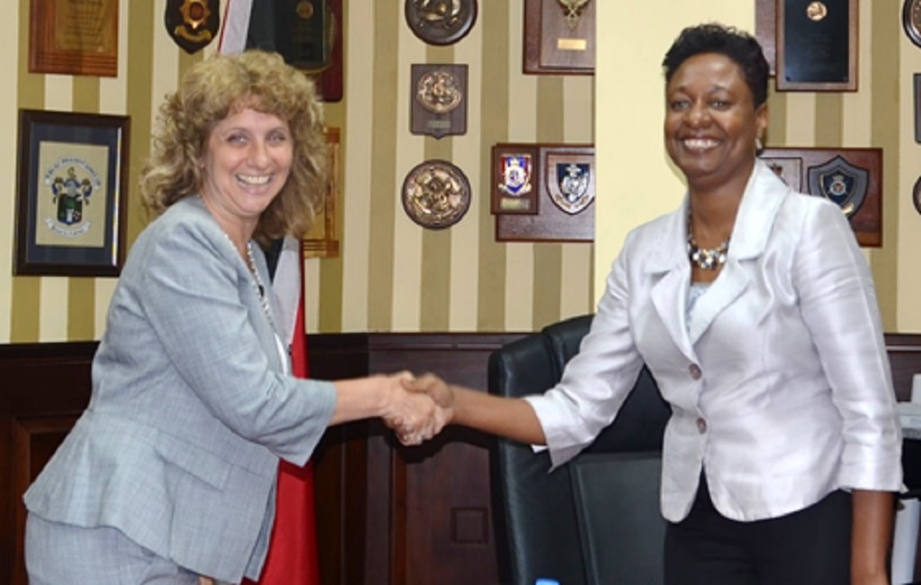 Ag Permanent Secretary in the Ministry of National Security, Penelope Bradshaw-Niles (right), greets Deputy Assistant Secretary, US Department of State Bureau of Population, Refugees and Migration, Nancy Izzo Jackson (left) during her visit to the Ministry of National Security.