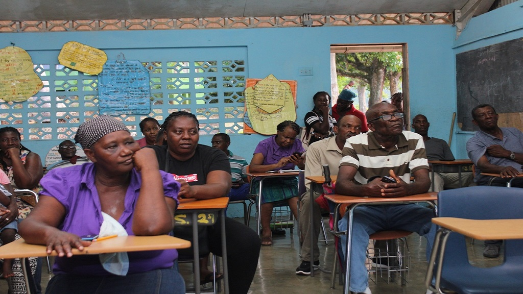 Residents of Ginger Ridge and Connors communities of west central St Catherine at a recent  community member.