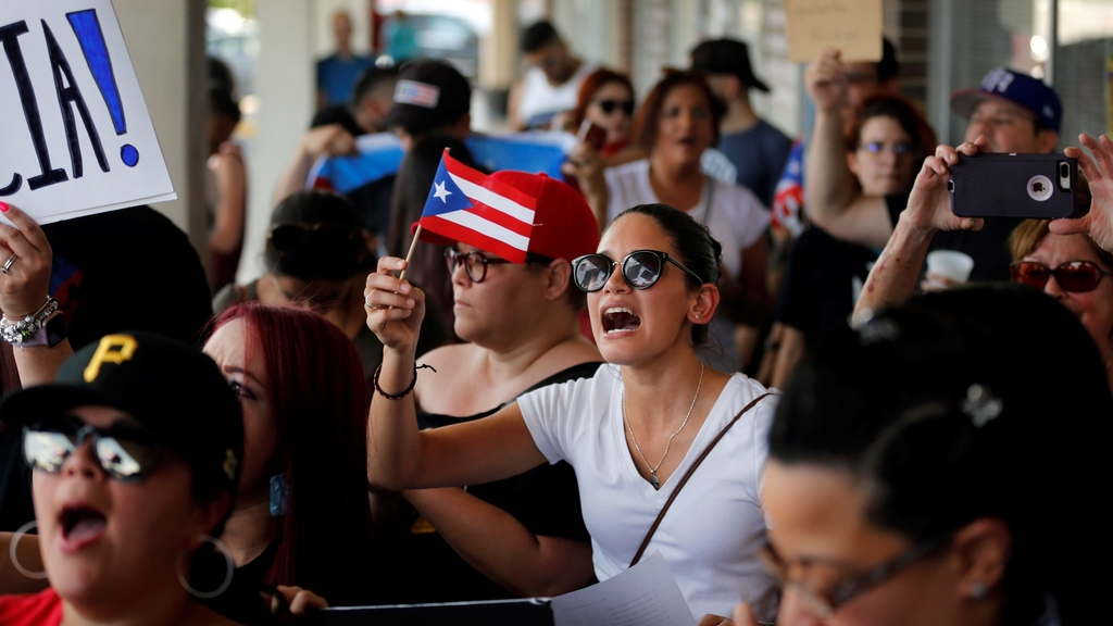 About 200-300 people from the North Texas (Dallas-Fort Worth area) Puerto Rican community gather to protest Gov. Ricardo Rossello outside the Adobo Puerto Rican Cafe in Irving, Texas, Sunday, July 21, 2019. (Tom Fox/The Dallas Morning News via AP)