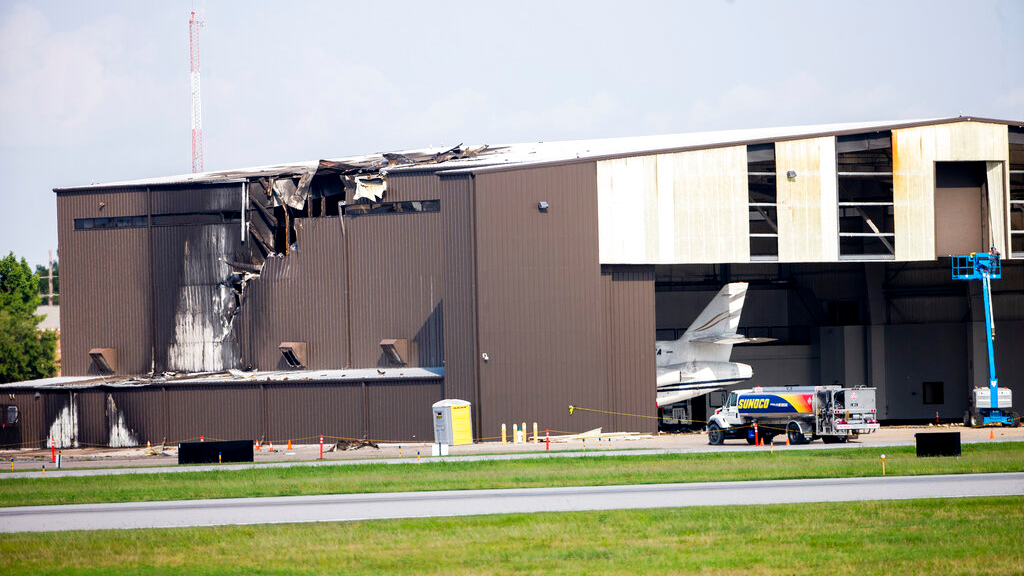 Damage is seen to a hangar after a twin-engine plane crashed into the building at Addison Airport in Addison, Texas, Sunday, June 30, 2019. (Shaban Athuman/The Dallas Morning News via AP)