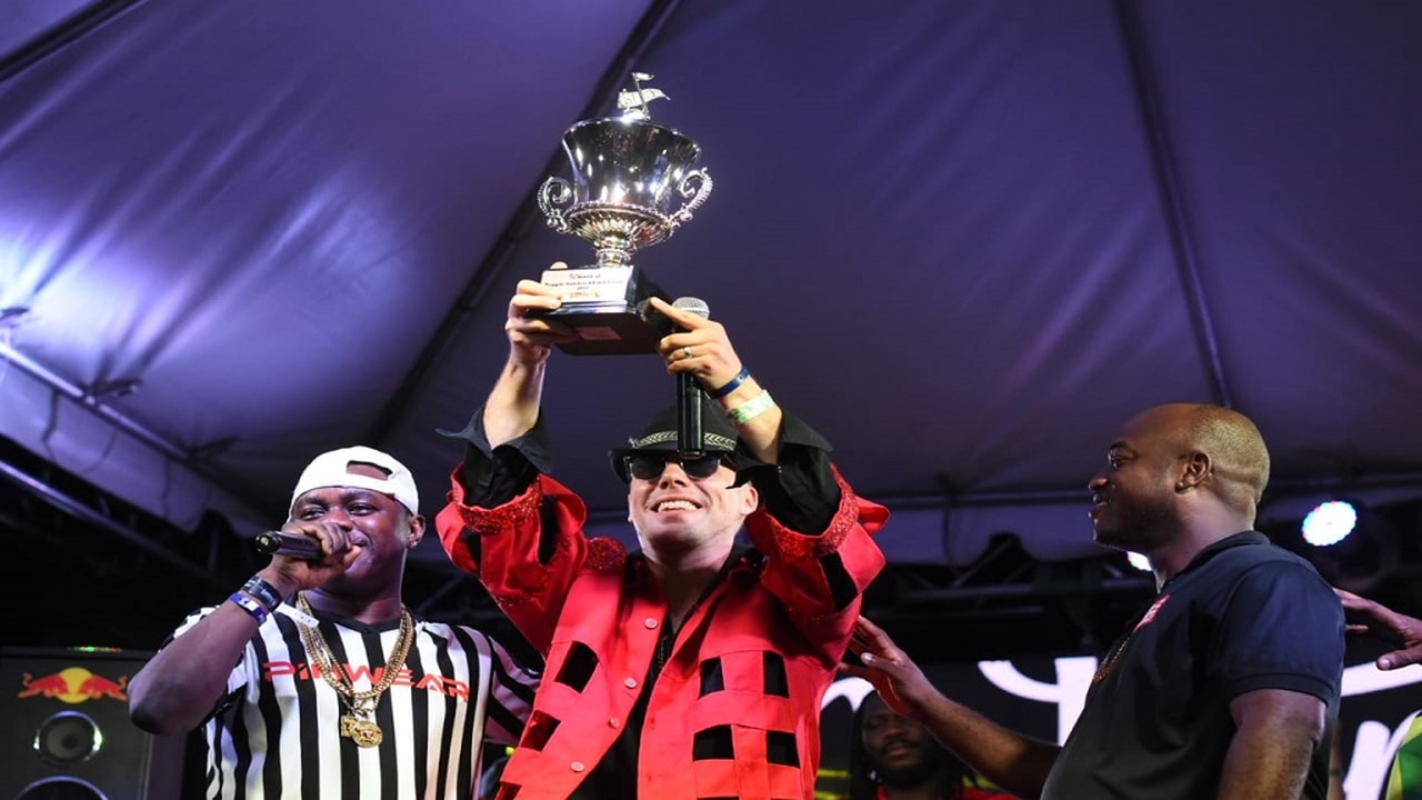 Dancehall selector Mattia of Warrior Sound hoists the winner's trophy after emerging victorious in the Reggae Sumfest Global Sound Clash at Pier One in Montego Bay, St James on Friday morning.