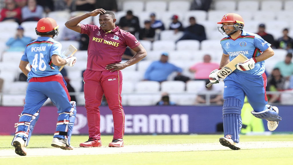 West Indies' Sheldon Cottrell, centre, reacts after bowling a delivery during the Cricket World Cup match against Afghanistan at Headingley in Leeds, England, Thursday, July 4, 2019. (AP Photo/Rui Vieira).