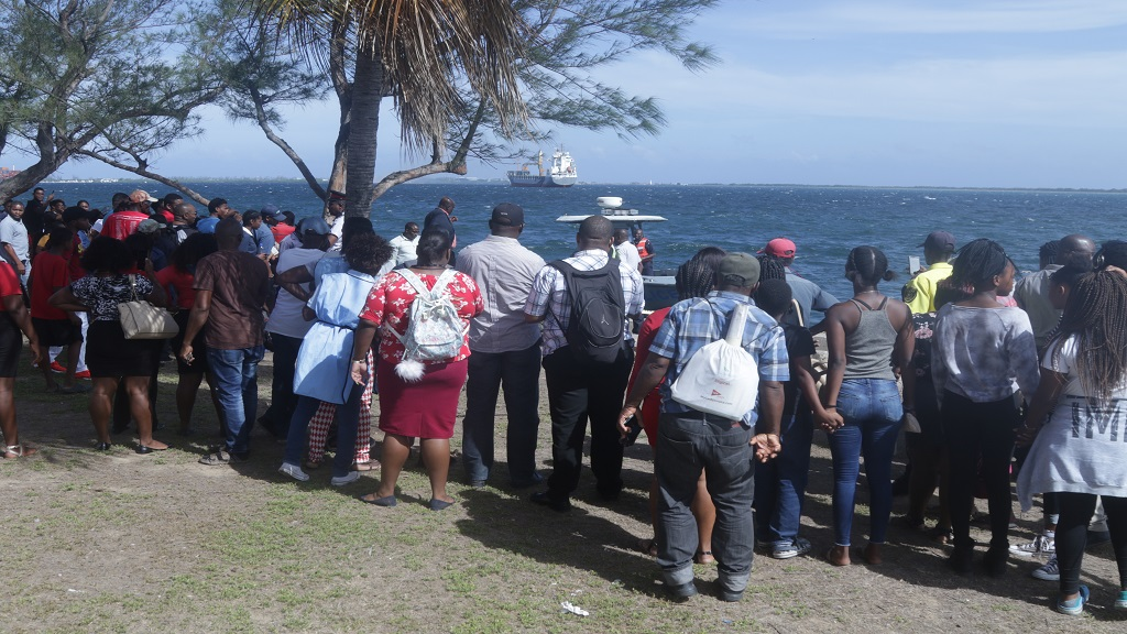 A crowd gathers at a section of the Kingston waterfront where a man is suspected to have jumped to his death on Tuesday. (PHOTOS: Shawn Barnes)