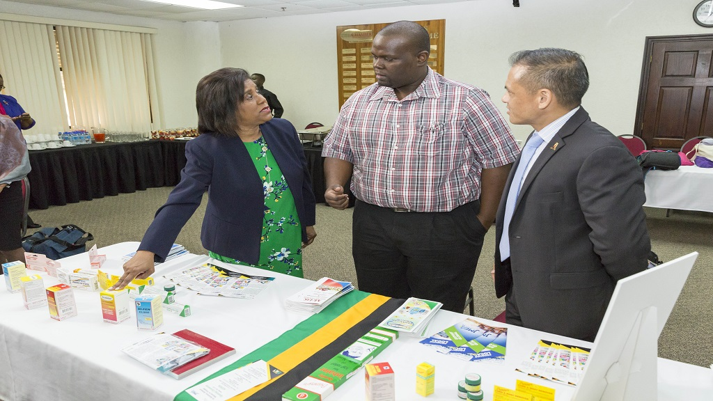 Senator the Honourable Paula Gopee Scoon, Minister of Trade and industry; Ian Taylor, General Manager of Jamaican company, Supreme Chemicals and Derek Luk Pat, Executive Director of Trinidad & Tobago Bureau of Standards take a look at Taylor's products after the opening ceremony of the JAMPRO and JMEA trade mission to Trinidad and Tobago.