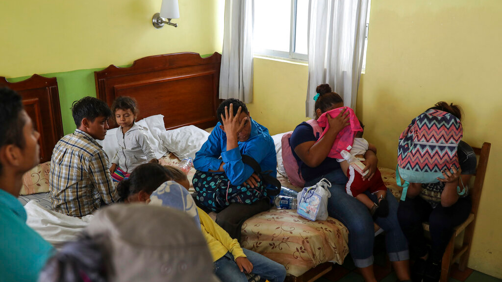 Central American migrants sit together inside a room at the Latino hotel during a raid by Mexican immigration agents in Veracruz, Mexico, Thursday, June 27, 2019. (AP Photo/Felix Marquez)