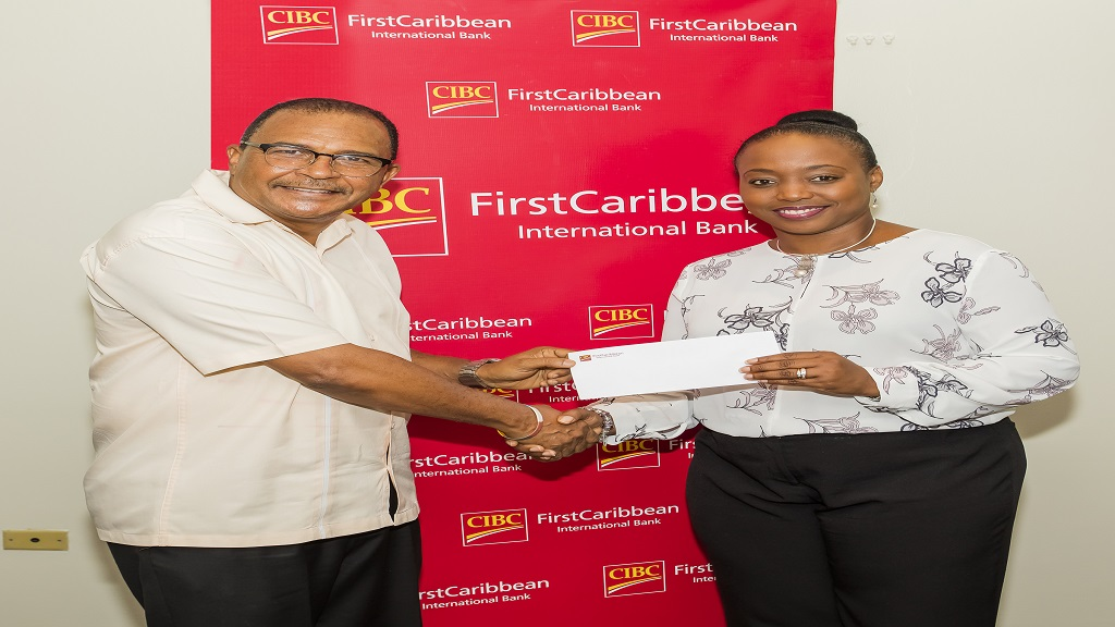 Renee Whitehorne (right), Marketing Manager, CIBC FirstCaribbean International Bank presents the bank's cheque to Rev. Peter Garth, Senior Pastor/Vice President, Associated Gospel Assemblies, in support of the Hope Gospel Assembly 2019 Back to School Fair.