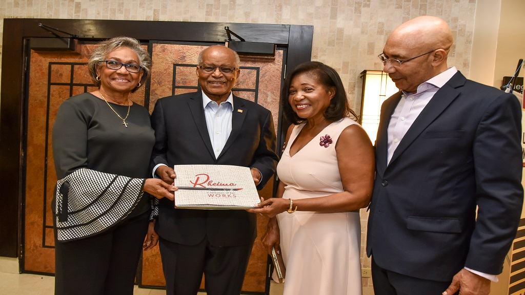 "(l-r) Former First Lady Rheima Hall and Sir Kenneth Hall, former Governor General of Jamaica, present a copy of ""Rheima – A Selection of her works"" to current First Lady Allen and Sir Patrick Allen, Governor General of Jamaica, at the launch of the book at the Jamaica Pegasus."