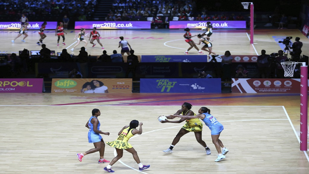 A general view of Jamaica against Fiji, foreground, with South Africa against Trinidad and Tobago on court two during the Netball World Cup match at the M&S Bank Arena in Liverpool, England, Friday, July 12, 2019. (Nigel French/PA via AP).