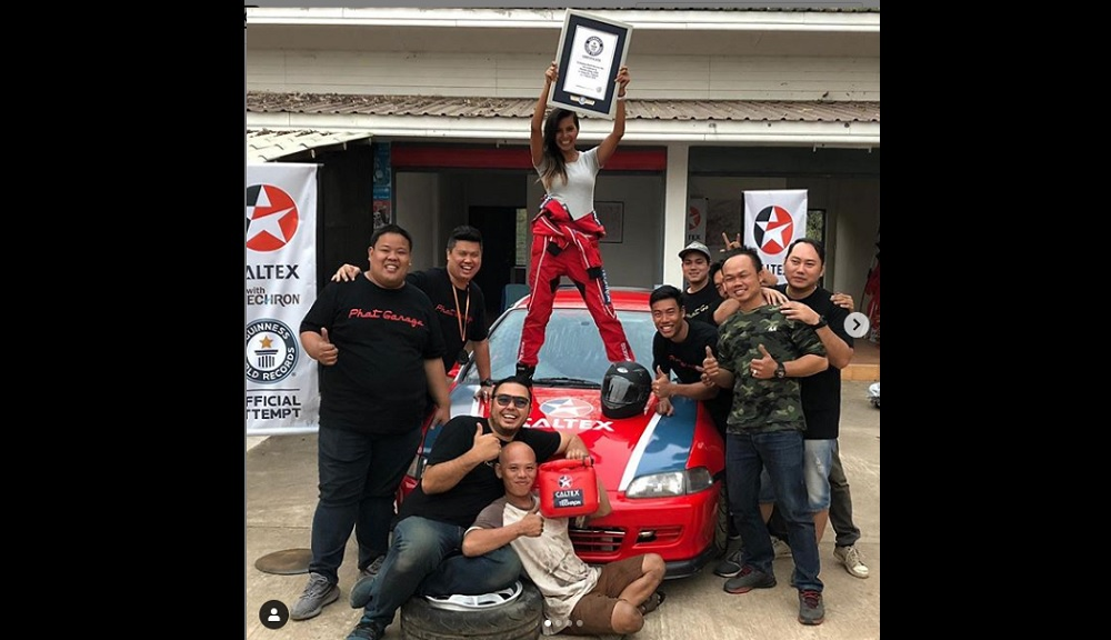 Jamaican race car driver Natasha Chang celebrates with her team after her record breaking feat in Thailand. (PHOTO: Instagram/Natasha Chang)
