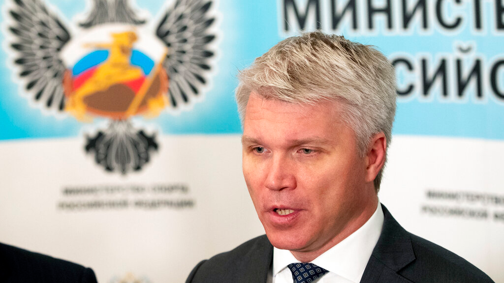 Russian Sports Minister Pavel Kolobkov speaks to the media in Moscow, Russia, Wednesday, July 24, 2019. With a year to go until the Olympics open in Tokyo, Russia believes it can emerge from the shadow of doping scandals and surge up the medal table. (AP Photo/Pavel Golovkin)