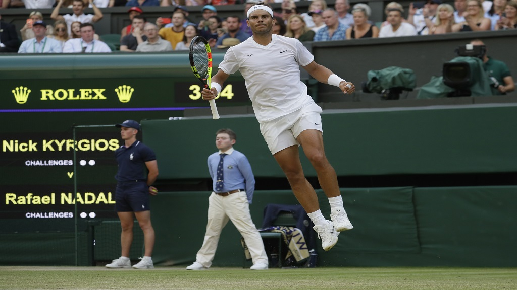 Spain's Rafael Nadal celebrates after beating Australia's Nick Kyrgios in a men's singles match during day four of the Wimbledon Tennis Championships in London, Thursday, July 4, 2019.