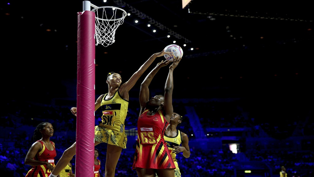 Jamaica's Shamera Sterling, left, challenges Uganda's Peace Proscovia during their Netball World Cup match in Liverpool, England, Thursday July 18, 2019. (Nigel French/PA via AP)