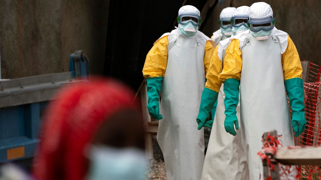 In this Tuesday, July 16, 2019 photo, health workers dressed in protective gear begin their shift at an Ebola treatment center in Beni, Congo DRC.  (AP Photo/Jerome Delay)
