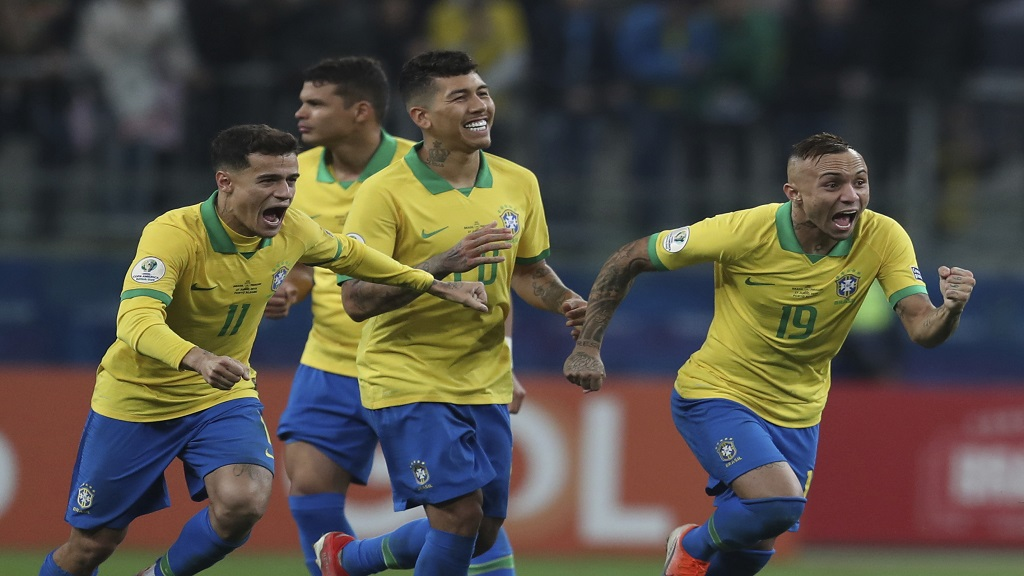 Brazil's players celebrate after winning the penalty shoot-out against Paraguay during a Copa America quarterfinal football match at the Arena do Gremio in Porto Alegre, Brazil, Thursday, June 27, 2019. (AP Photo/Natacha Pisarenko).