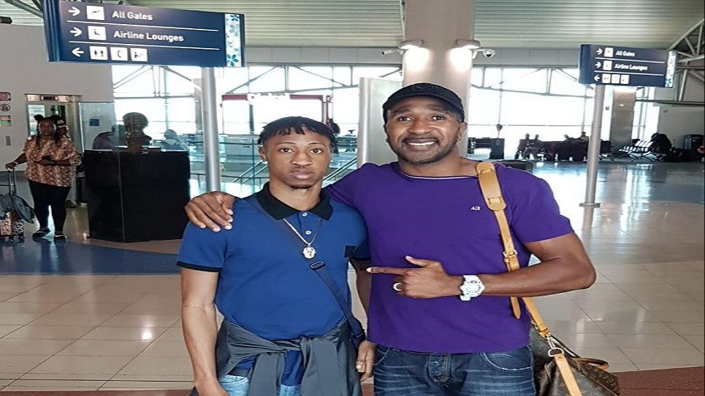 Former Jamaica College Digicel Manning Cup standout, Norman Campbell (right) and former Jamaica and Stoke City forward, Ricardo Fuller at the  Norman Manley International Airport in Kingston.