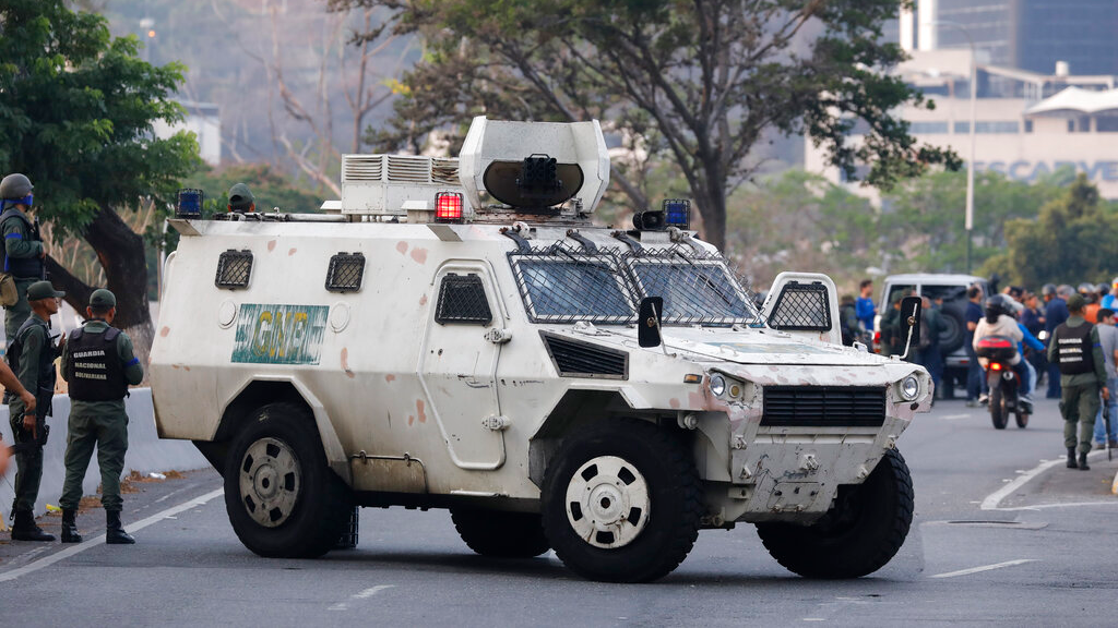 A military vehicle blocks an avenue next to La Carlota air base in Caracas, Venezuela, Tuesday, April 30, 2019. Venezuelan opposition leader Juan Guaido has called for a military uprising, in a video shot at the air base showing him surrounded by soldiers and accompanied by detained activist Leopoldo Lopez. (AP Photo/Ariana Cubillos)