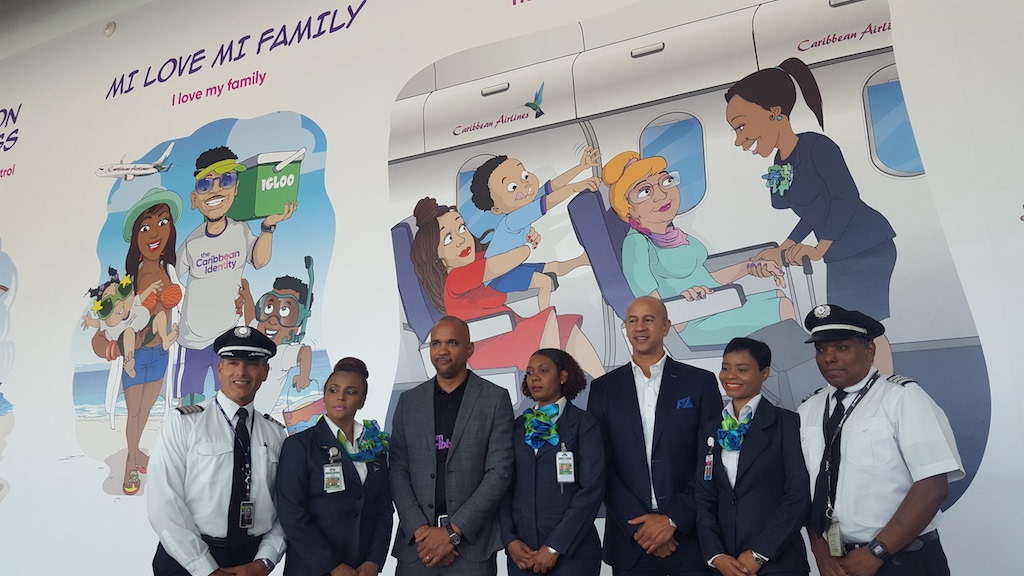 The Caribbean Airlines team including CEO Garvin Madera (third left) and board member Zachary Harding (third right) at the launch of the mural at the Norman Manley International Airport in KIngston. (PHOTOS: Marlon Reid)