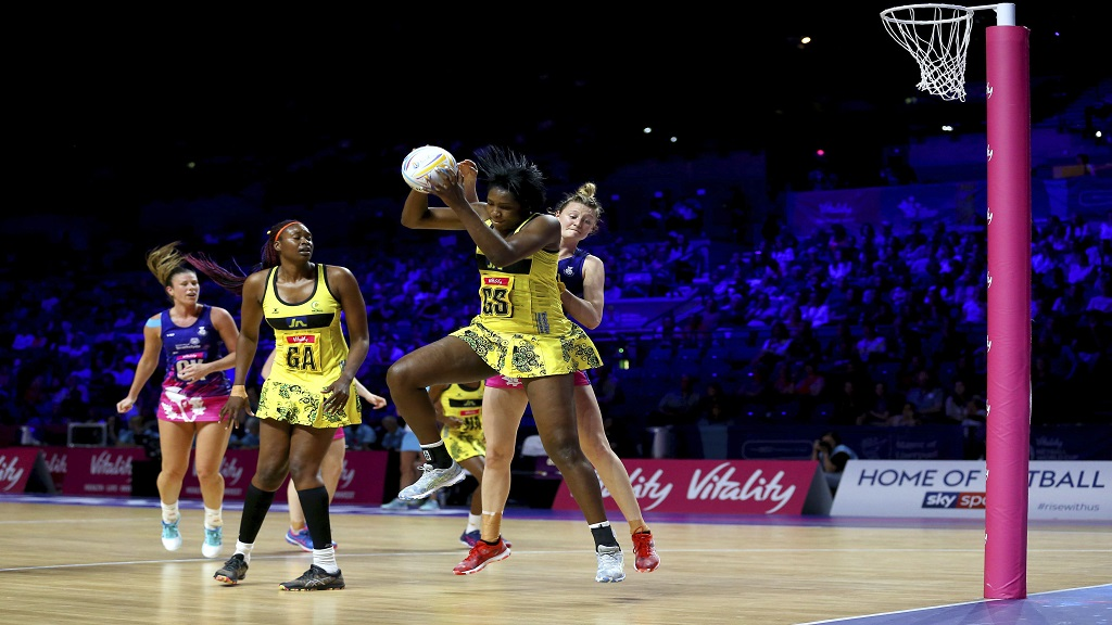 Jamaica's Jhaniele Fowler, front, and Scotland's Ella Gibbons in action during the Netball World Cup match in Liverpool, England, Wednesday July 17, 2019. (Nigel French/PA via AP).