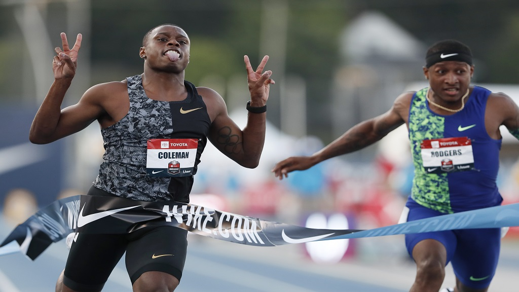 Christian Coleman celebrates in front of Michael Rodgers, right, as he wins the men's 100m dash final at the U.S. Championships athletics meet, Friday, July 26, 2019, in Des Moines, Iowa.