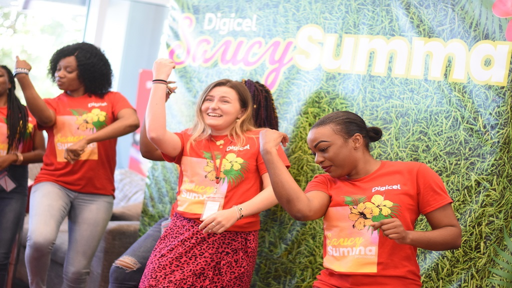Digicel customers dance  at the company's launch of its Saucy Summa summer promotion on Friday. (PHOTOS: Marlon Reid)