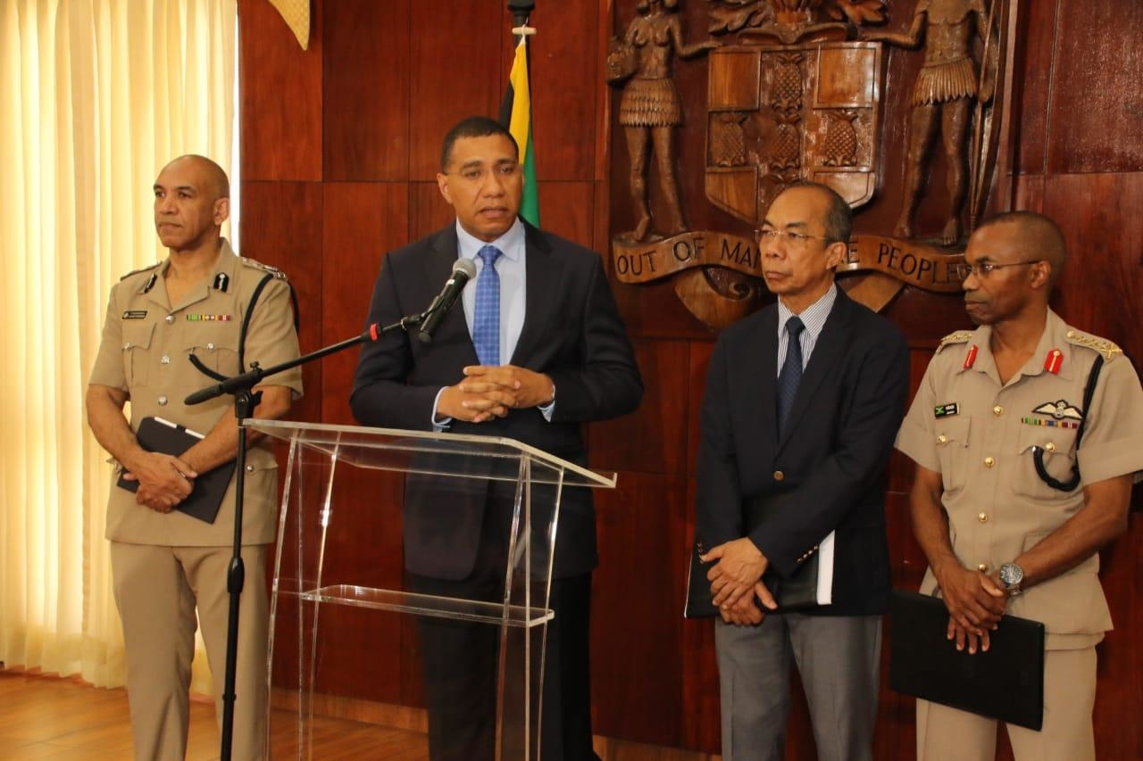Prime Minister Andrew Holness (second left) at a press conference at Jamaica House on Sunday at which a state of emergency was announced for the St Andrew South Police Division. Also pictured (l-r) are Police Commissioner, Major General Antony Andreson; National Security Minister, Dr Horace Chang; and Chief of Defence Staff, Lieutenant General Rocky Meade.