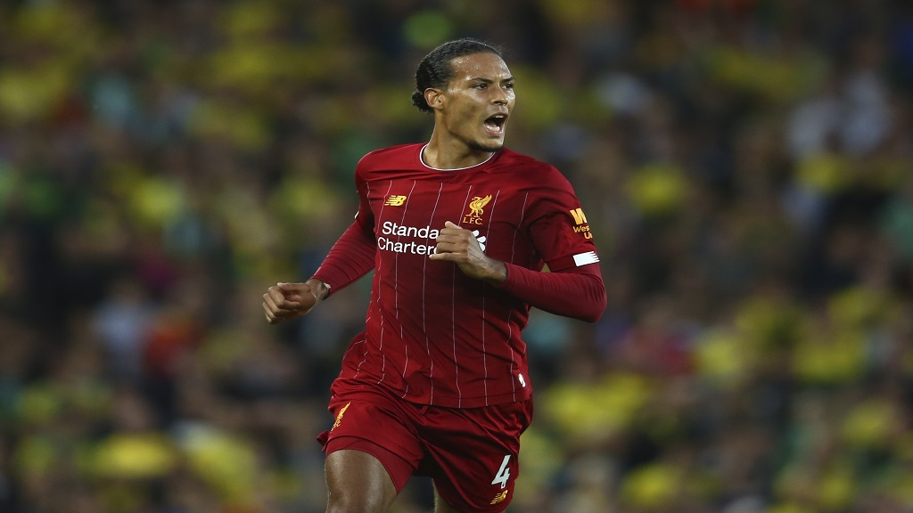 Liverpool's Virgil van Dijk celebrates after scoring his side's third goal during the English Premier League football match against Norwich City at Anfield in Liverpool, England, Friday, Aug. 9, 2019. (AP Photo/Dave Thompson).