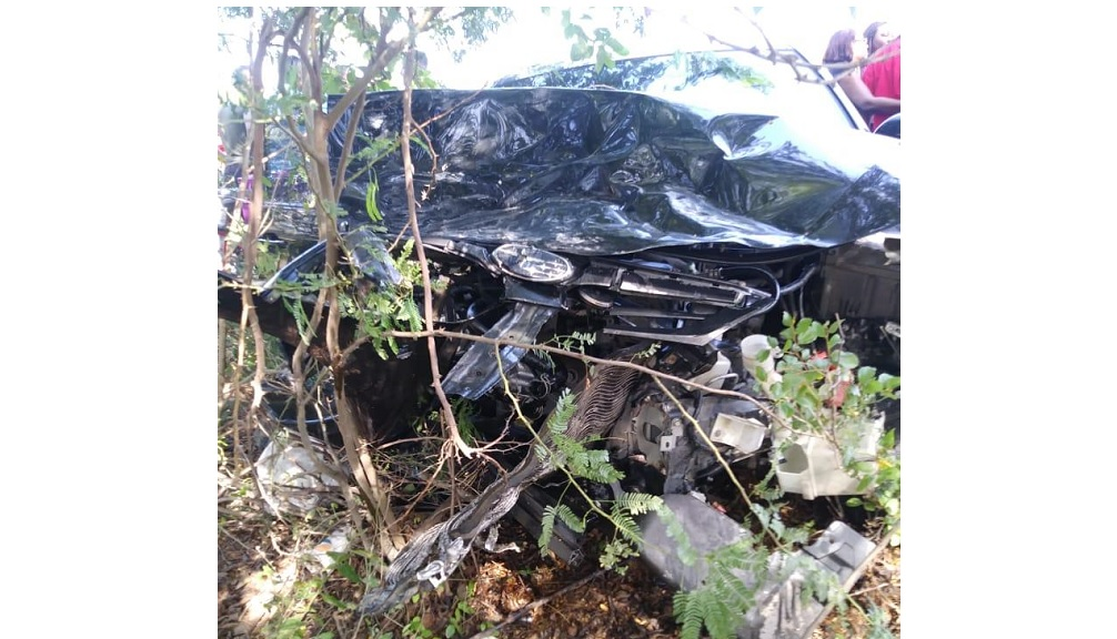 The mangled remains of a motor vehicle involved in a collision along Dyke Road in Portmore on Monday. Three persons died in the incident.