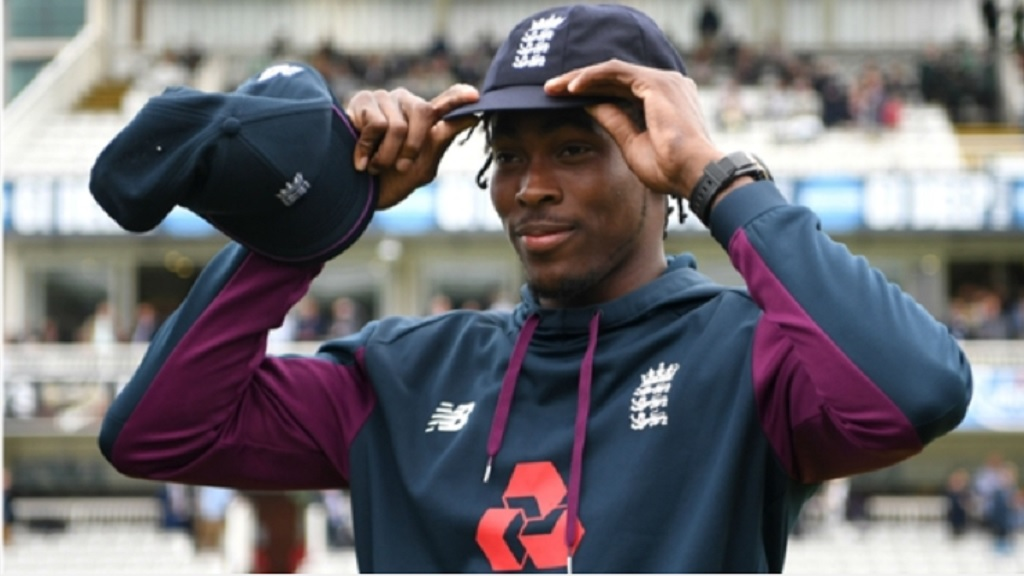 Jofra Archer puts on his Test cap.