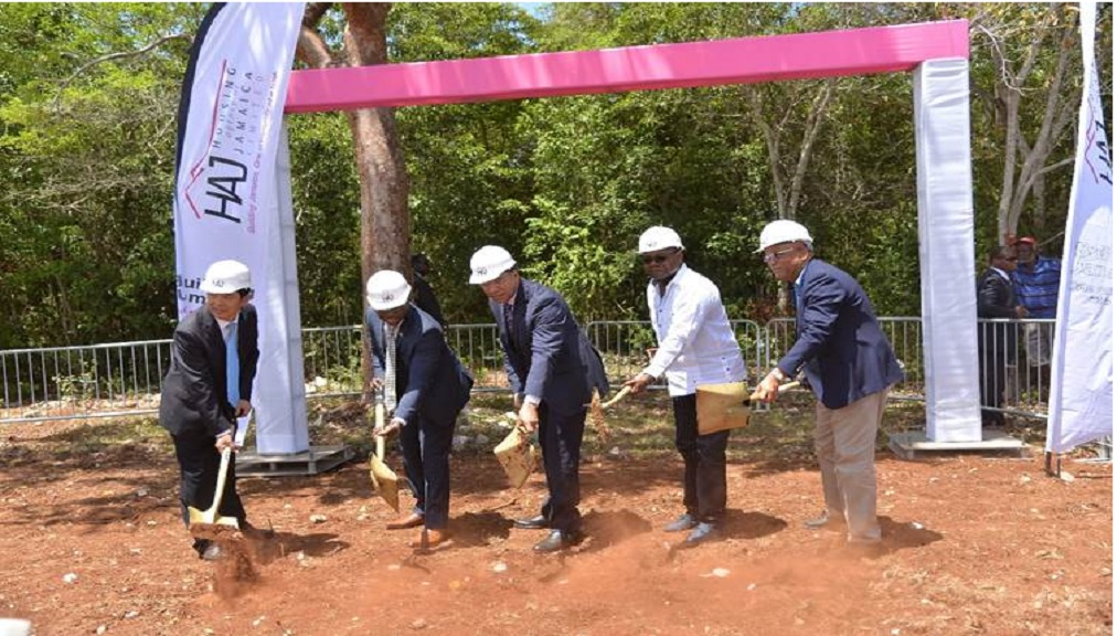 Prime Minister Andrew Holness (C) and Minister of Tourism,  Edmund Bartlett (1st R) officially broke ground  on Friday for the Rhyne Park development in Montego Bay that will see 754 mixed units being constructed. Joining in the occasion (l-R) are Baoguo Chen, General Manager Henan Fifth Construction Group and Norman Brown, chairman, Housing Agency of Jamaica Board of Directors.)