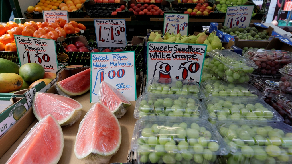 A fruit stall displays fruit at a market in London, Wednesday, Aug. 7, 2019. The U.K. food industry is asking the government to set aside competition rules so companies can coordinate supply decisions to combat shortages in the event Britain leaves the European Union without an agreement on future trade relations. (AP Photo/Kirsty Wigglesworth)