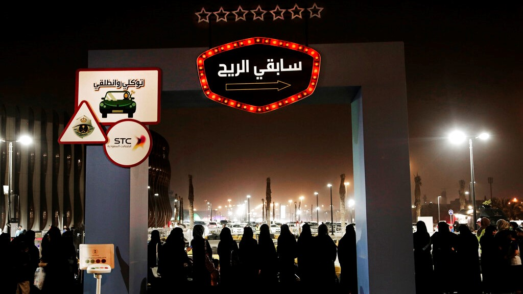 In this June 22, 2018, file photo, women wait in line to ride go carts at a road safety event for female drivers launched at the Riyadh Park Mall in Riyadh.  (AP Photo/Nariman El-Mofty, File)