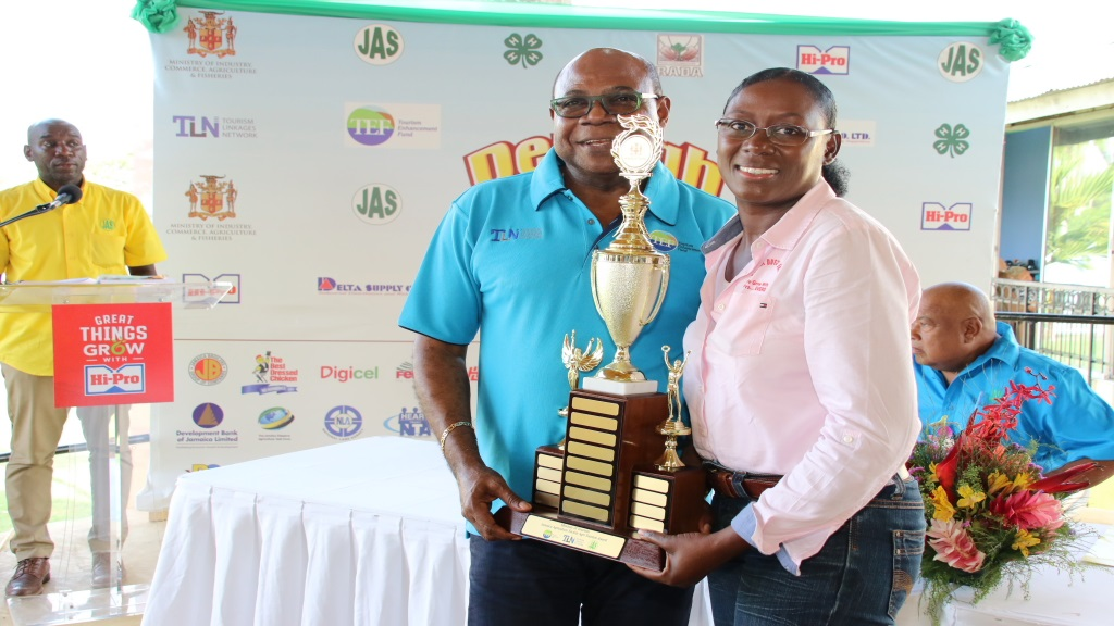 Tourism Minister, Edmund Bartlett, makes a special presentation on day one of the Denbigh Show in Clarendon.
