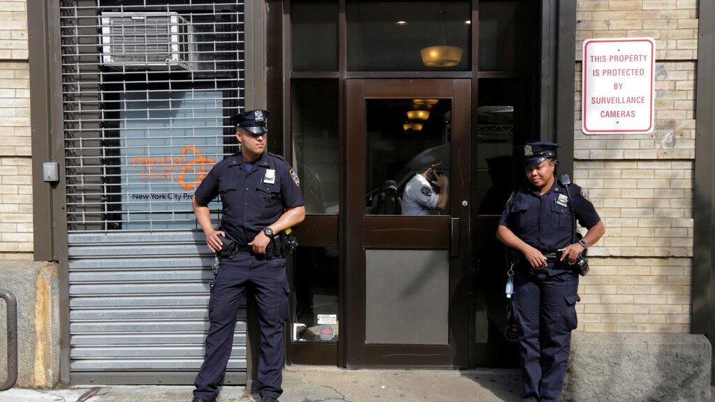 In this Thursday, June 21, 2018 file photo, police stand outside an office for the Cayuga Centers in the Brooklyn borough of New York. (AP Photo/Richard Drew)