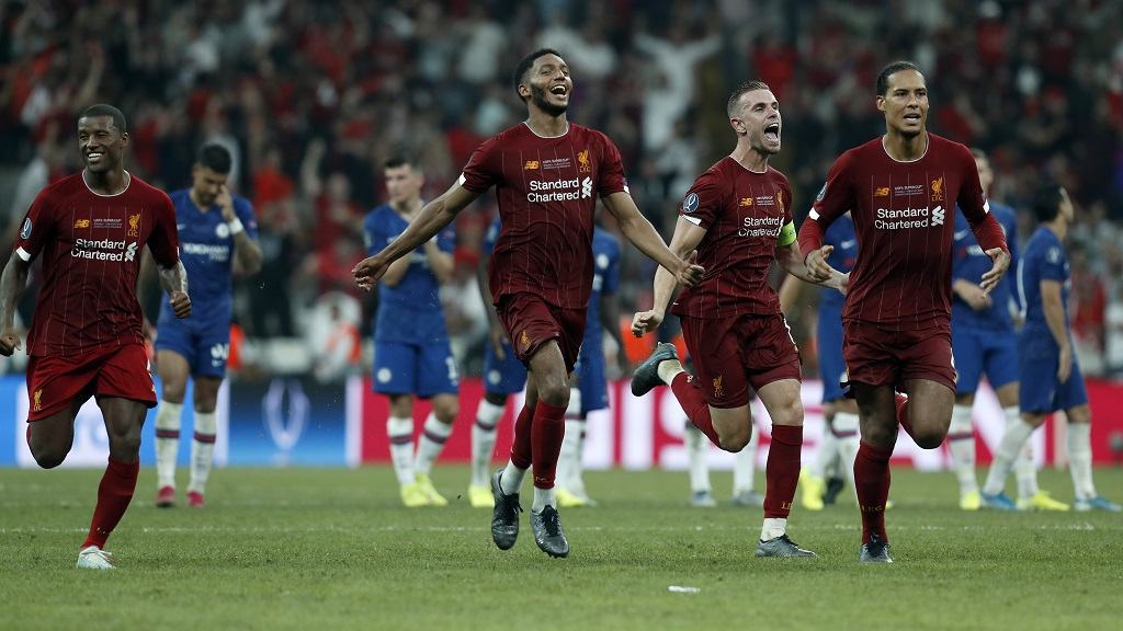 Liverpool teammates celebrate after winning the UEFA Super Cup football match against Chelsea, in Besiktas Park, in Istanbul, Wednesday, Aug. 14, 2019.(AP Photo/Lefteris Pitarakis).