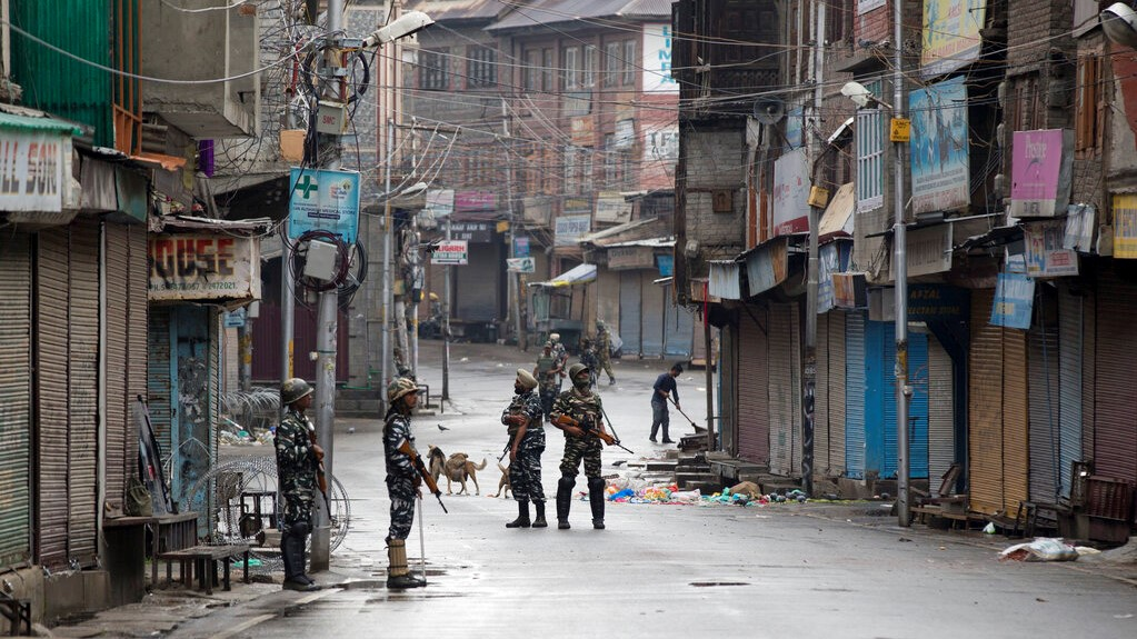 Indian Paramilitary soldiers stand guard on a deserted street during curfew in Srinagar, Indian controlled Kashmir, Thursday, Aug. 8, 2019. (AP Photo/Dar Yasin)