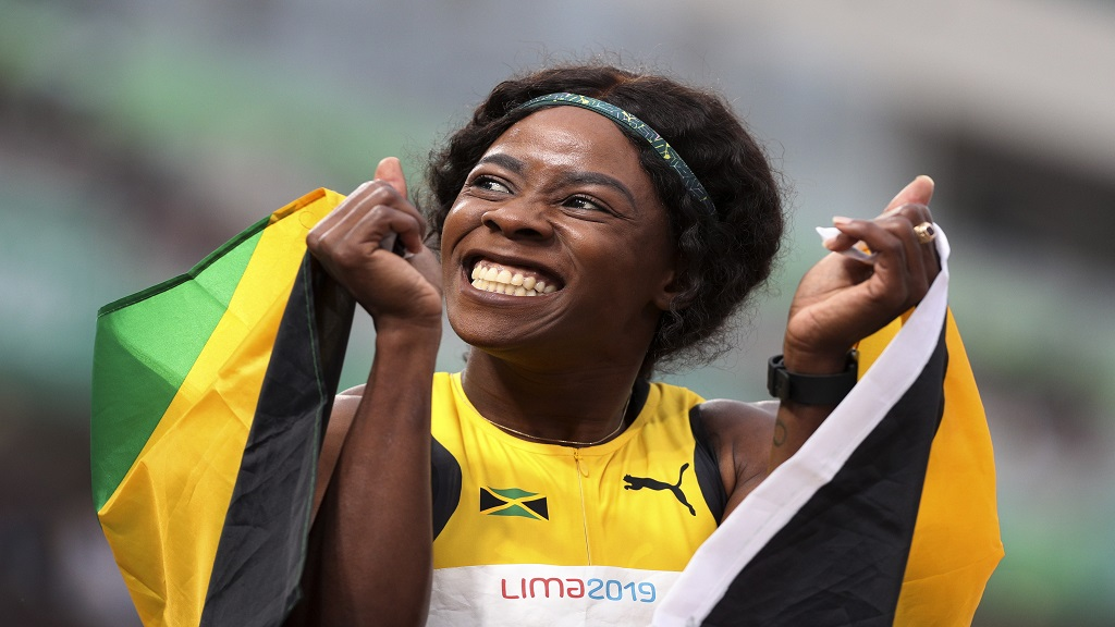 Shericka Jackson of Jamaica celebrates winning the gold medal in the women's 400m final during the athletics at the Pan American Games in Lima, Peru, Thursday, Aug. 8, 2019. (AP Photo/Martin Mejia).