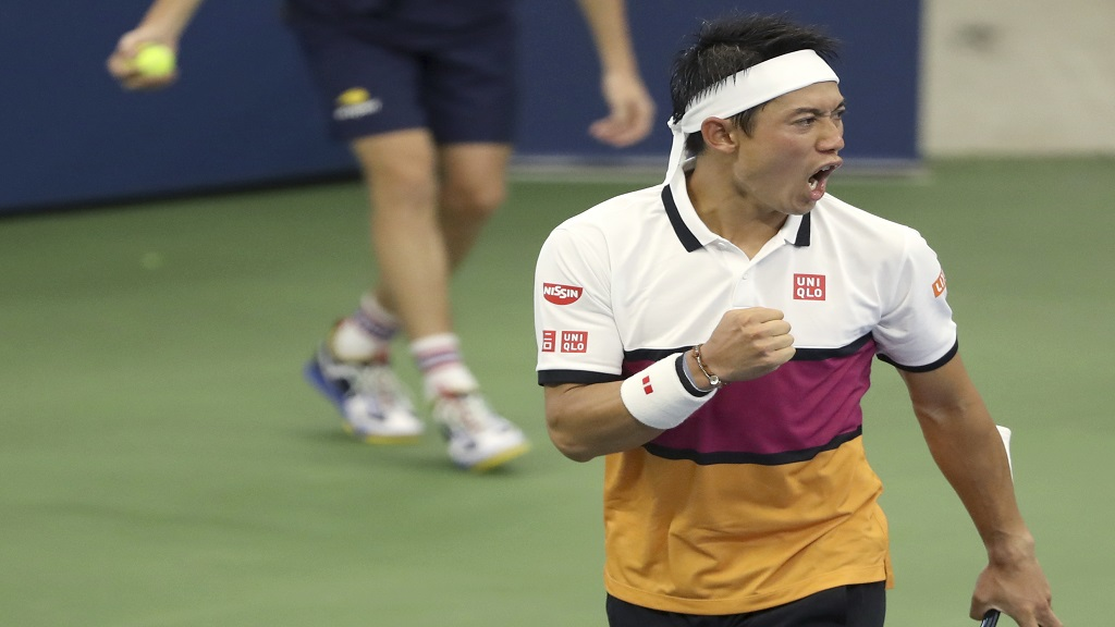 Kei Nishikori, of Japan, reacts after scoring a point against Bradley Klahn, of the United States, during the second round of the US Open tennis championships Wednesday, Aug. 28, 2019, in New York. (AP Photo/Kevin Hagen).