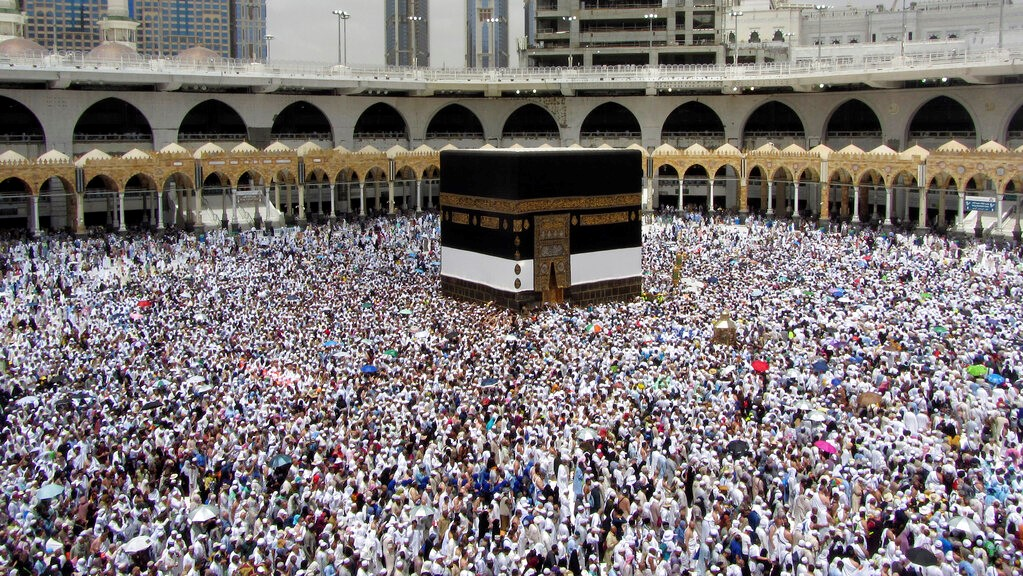 In this Thursday, Aug. 8, 2019 file photo, Muslim pilgrims circumambulate around the Kaaba, the cubic building at the Grand Mosque, ahead of the Hajj pilgrimage in the Muslim holy city of Mecca, Saudi Arabia. (AP Photo/Amr Nabil, File)
