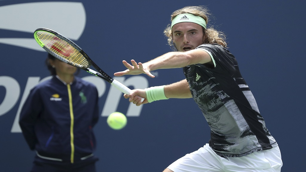 Stefanos Tsitsipas, of Greece, returns a shot to Andrey Rublev, of Russia, during the first round of the US Open tennis tournament Tuesday, Aug. 27, 2019, in New York. (AP Photo/Kevin Hagen).