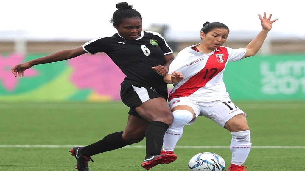 Mireya  Grey (left) of Jamaica challenges a defender from Peru during the 7th to 8th place match at the Pan American Games in Lima, Peru on August 6, 2019.
