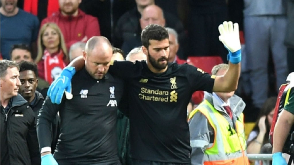 Liverpool goalkeeper Alisson goes off injured against Norwich City.