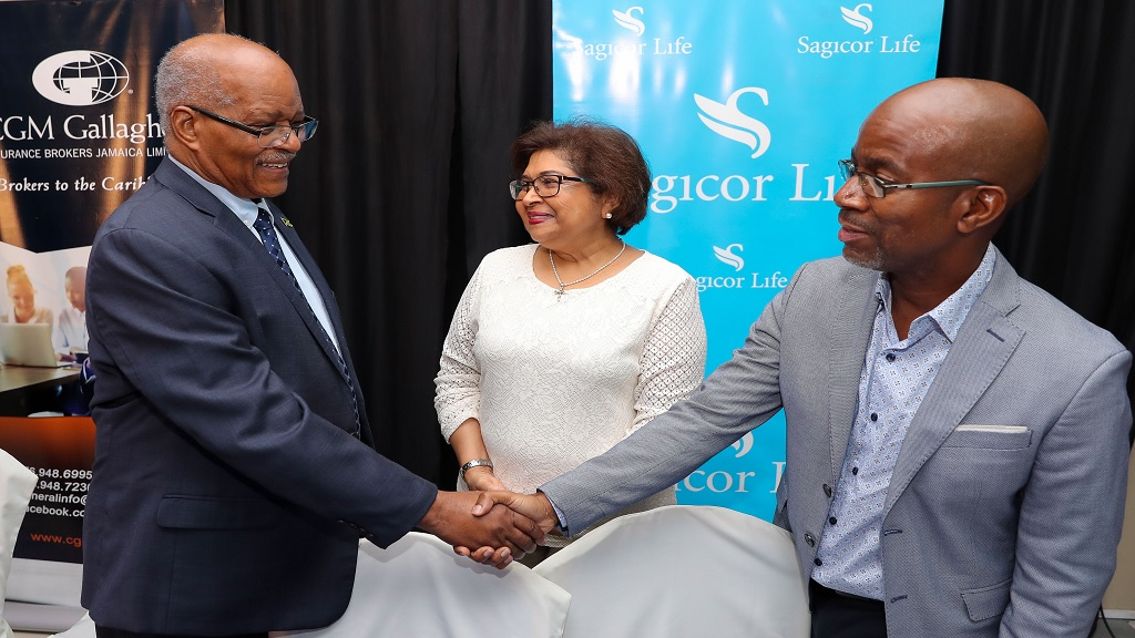 CCRP executive chair Jean Lowrie-Chin introduces former Governor General Sir Kenneth Hall (left) to Willard Brown, Executive Vice President Employee Benefits Division, Sagicor Life. The occasion was the launch of a new comprehensive health designed by CGM Gallagher Insurance Brokers and underwritten by Sagicor Life for CCRP members.