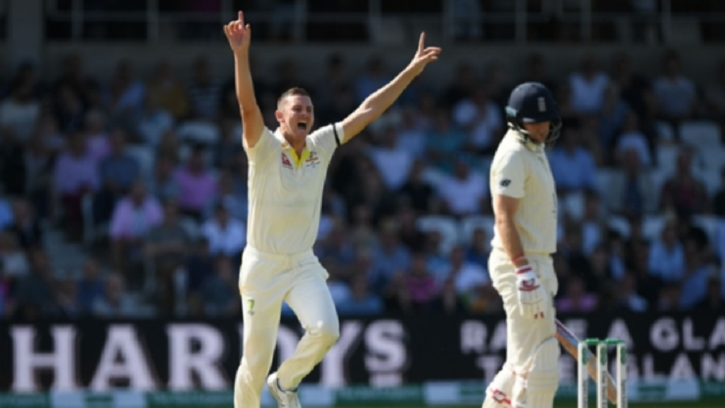 Josh Hazlewood celebrates dismissing Joe Root.