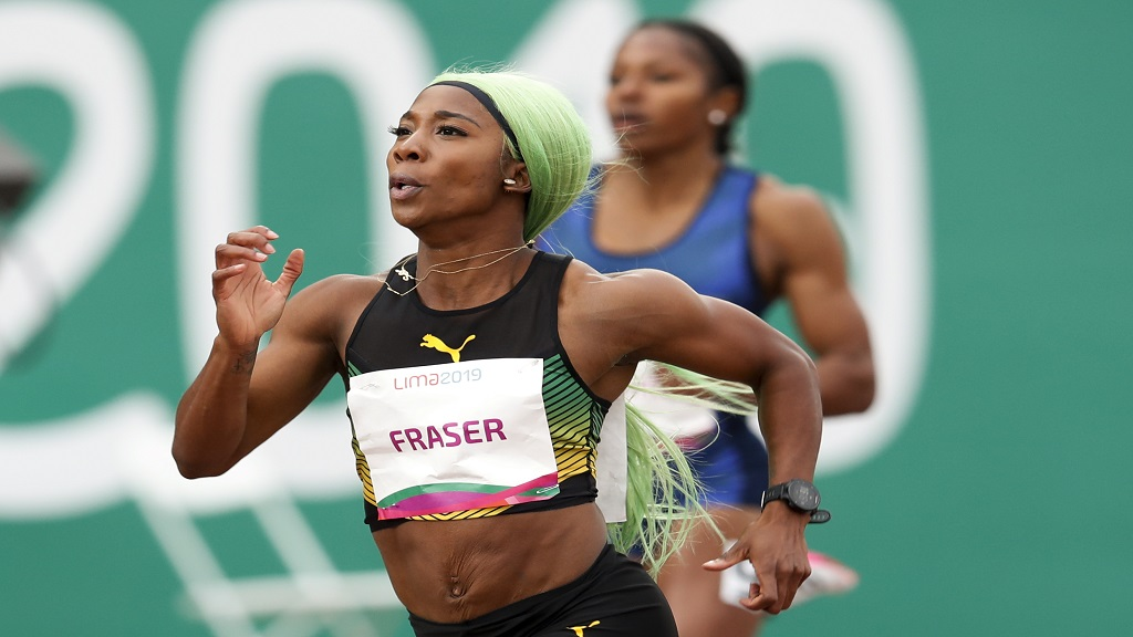 Shelly-Ann Fraser-Pryce of Jamaica runs to win the gold medal in the women's 200m final during the athletics at the Pan American Games in Lima, Peru, Friday, Aug. 9, 2019. (AP Photo/Moises Castillo).