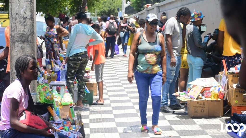 Shoppers look for school supplies in downtown Kingston on Thursday.