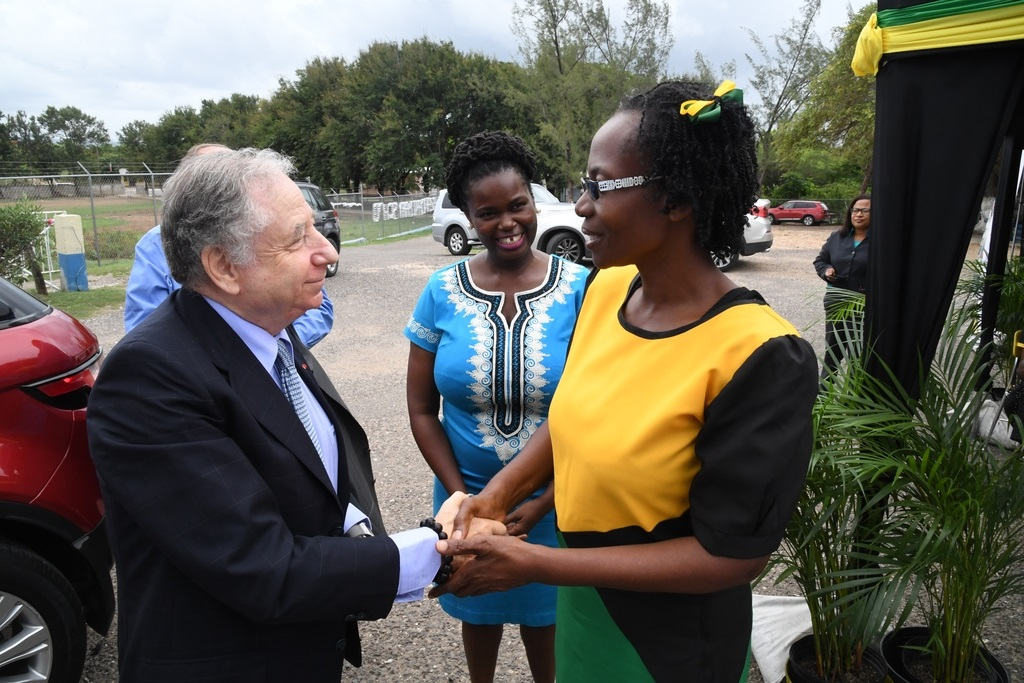 Jean Todt (left), president of the Federation Internationale de L'Autombile (FIA) Foundation and UN Special Envoy for Road Safety greets Sonia Thomas, vice principal of Hazard Primary School in Clarendon at a tour of the school recently. Looking on is Onyka Barrett Scott (centre), general manager of the JN Foundation.